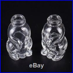 Antique silver pair of salt and pepper shakers in a shape of the dog, spaniel