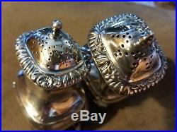 Antique sterling footed salt & pepper shakers with lions head, Birks, England