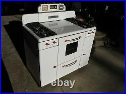 Vintage Tappan gas stove with Salt & Pepper Shakers 1950's White with Red Trim- NICE